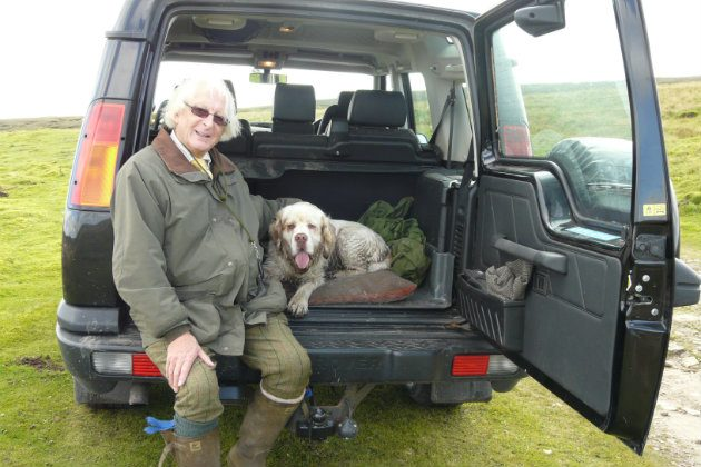 Clumber spaniel with owner