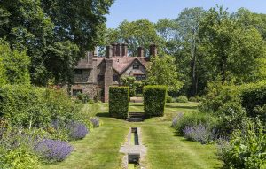 A magnificent Surrey manor house that boasts gardens designed by Gertrude Jekyll
