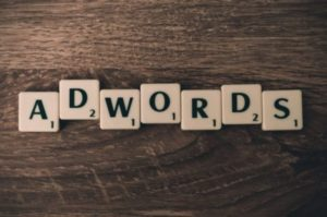 ppc advertising - image of scrabble letters spelling out Adwords